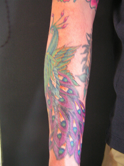 Cute Peacock Tattoo Design on Hand