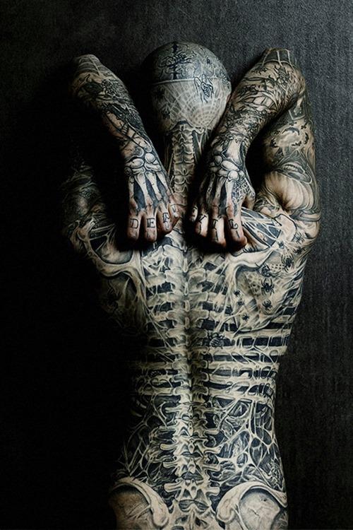 Weird Back Tattoo for Men