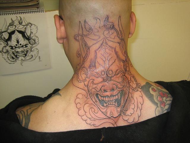 Creative Neck Tattoo Design for Men