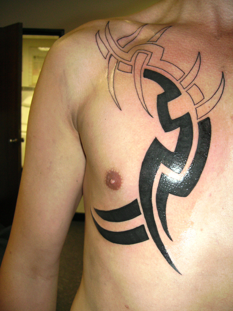 Half Chest Tribal Tattoo