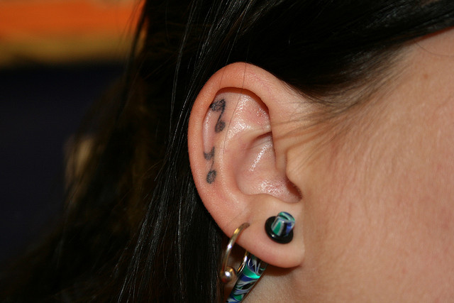 Unique Ear Tattoo Design