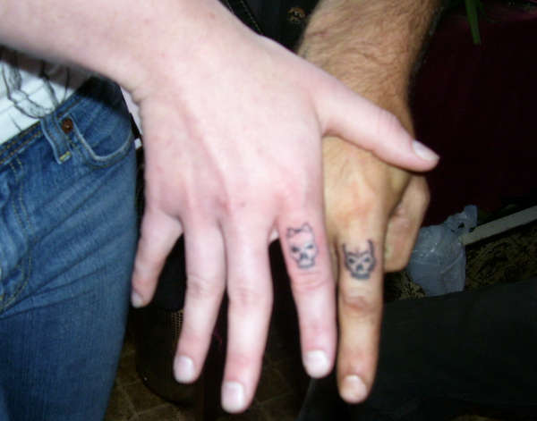 Skull Ring Tattoo Design