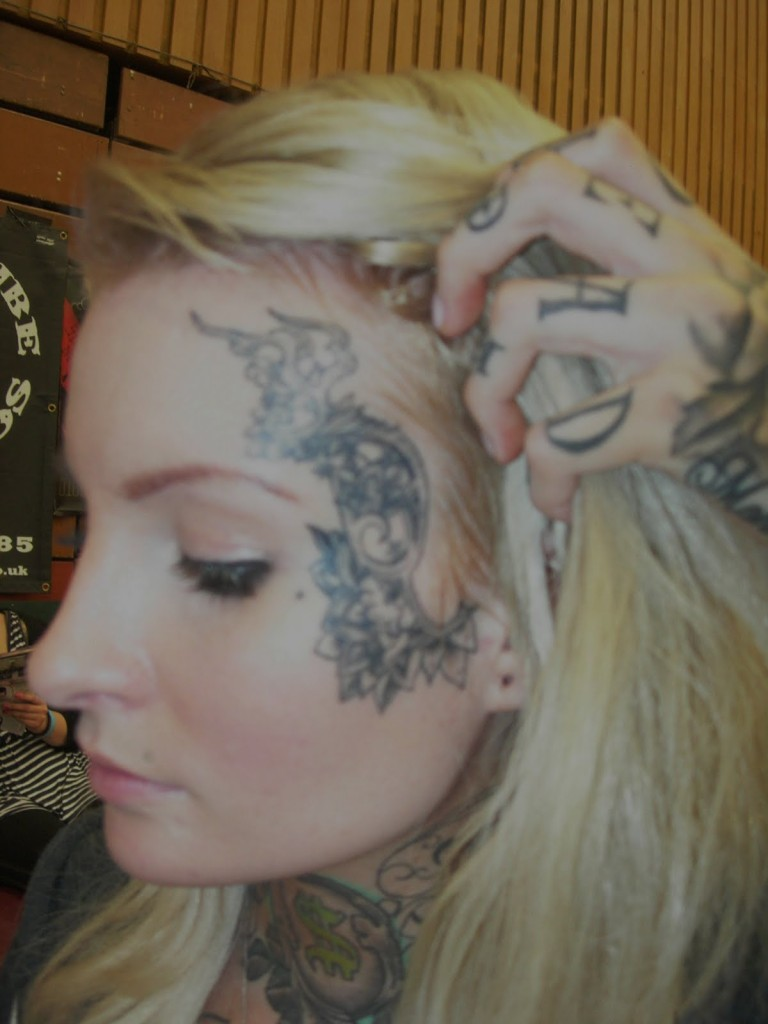 Half face tattoo