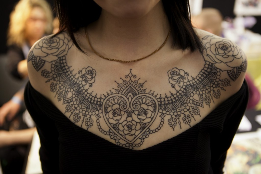 Permanent neck lace tattoo