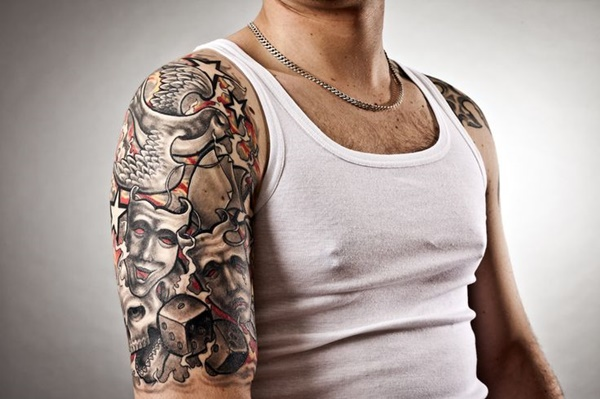An image of a handsome man with tattoos